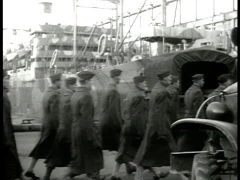 camouflaged transport ship at dock ms soldiers marching on dock la ms officers talking ms soldiers boarding ship la vs waving from deck railings... - 1941 stock videos & royalty-free footage