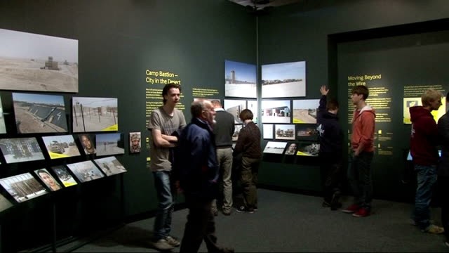 camp bastion exhibition at imperial war museum england london lambeth imperial war museum int people looking at 'war story supplying frontline... - lambeth stock videos & royalty-free footage