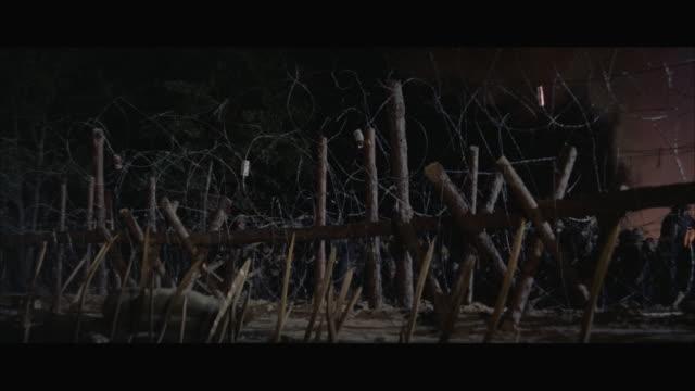 ws camp battle with heavy explosions / vietnam - guerra del vietnam video stock e b–roll