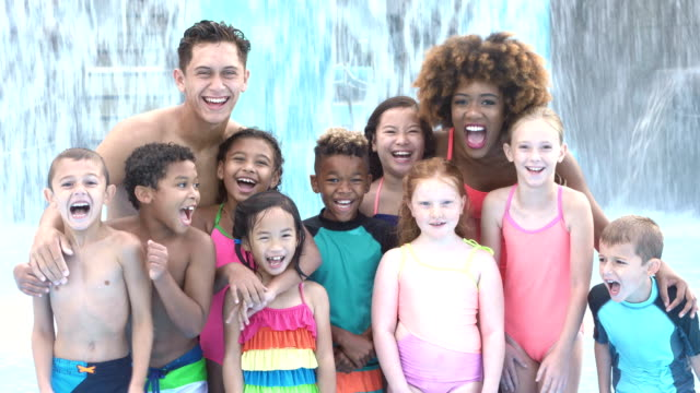 camp counselors with multi-ethnic children at water park - summer camp helper stock videos & royalty-free footage