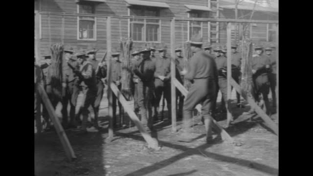 Pan shot as Albany NYarea trainees in the 303rd Infantry participate in bayonet drills in preparation for service in WWI / draftees march / Major...