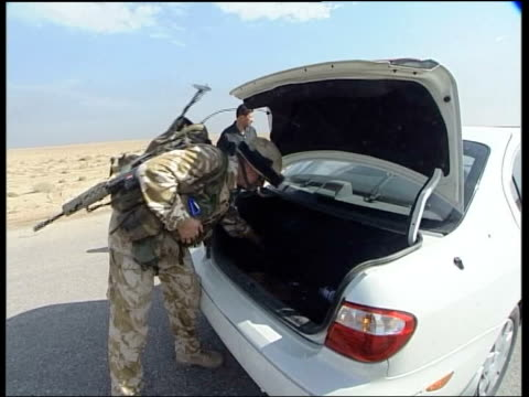 british troops change tactics to counter suicide bombers; pool iraq: camp dogwood: ext soldiers from black watch regiment running away to helicopter... - al fallujah stock videos & royalty-free footage