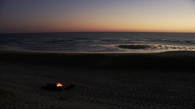 WS Camp fire on atlantic coast at after sunset / Cap de l'Homy, Aquitaine, France