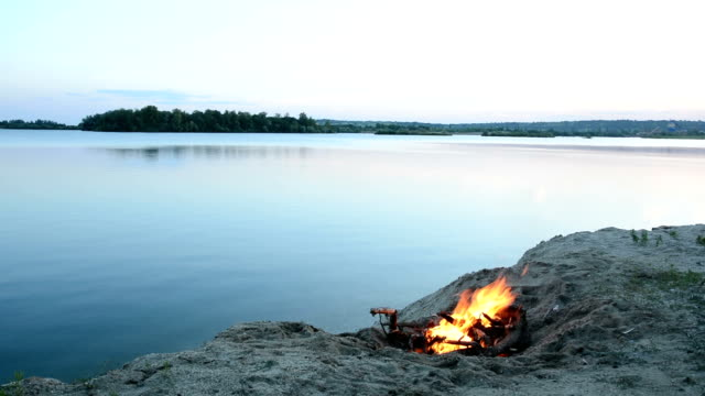 camp fire on the lakeshore - lakeshore stock videos and b-roll footage