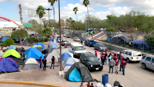 camp for asylum seekers stands next to the international bridge to the united states on december 09, 2019 in matamoros, mexico. more than 1,000... - geographical border stock videos & royalty-free footage
