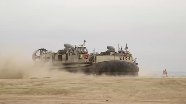 camp pendleton calif memebers of the japanese self defense force offload personnel and vehicles from the japanese ship huyga here may 31 dawn blitz... - japan self defense forces stock videos and b-roll footage