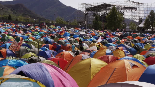 camp site on the midi music festival in beijing - medium shot. - camping stock videos & royalty-free footage