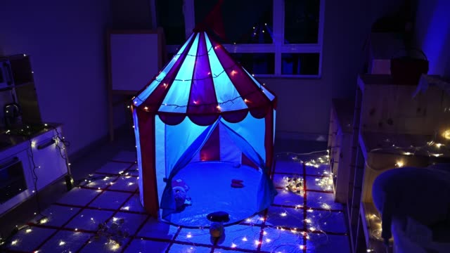 camp tent in child playroom at night illuminated - malaysia stock videos & royalty-free footage