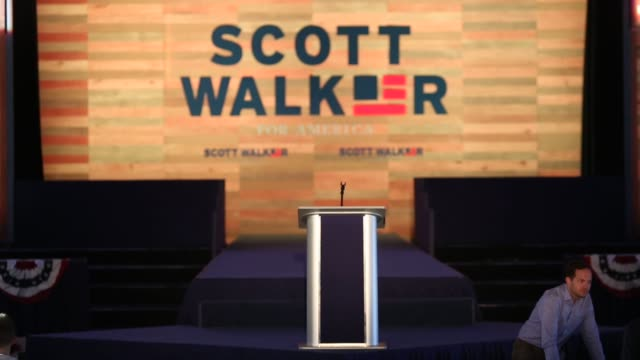 campaign officials set up and supporters arrive before an event where wisconsin governor scott walker is expected to announce his bid for the 2016... - pledge of allegiance stock videos & royalty-free footage