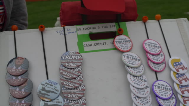 Campaign pins for sale before 2016 Republican presidential candidate Donald Trump speaks during a campaign stop and town hall at the Palladium at the...