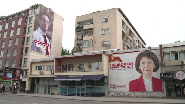 campaign posters line the streets of skopje as north macedonia gears up for a presidential run off on sunday between the ruling party's favoured pick... - skopje stock videos and b-roll footage