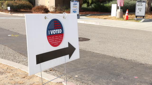 campaign signs stand on a sidewalk on election day on november 3 in santa clarita, california. voters are going to the polls to vote for either... - santa clarita stock videos & royalty-free footage