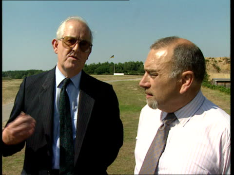 campaign to ban handguns; england: surrey: bisley: tony hill along chatting pat johnson bv ditto cms hill along man standing on shooting range l-r to... - dunblane stock videos & royalty-free footage