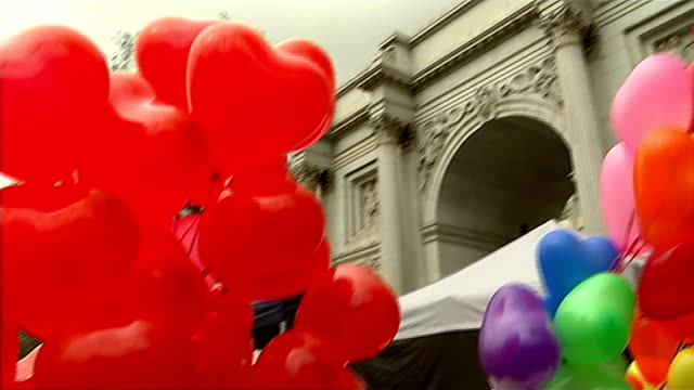 campaign to combat sexual and domestic violence against women; england: london: marble arch: ext heart shaped balloons women playing drums women sat... - itv london tonight weekend stock videos & royalty-free footage