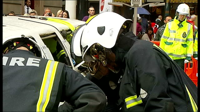 tfl campaign to highlight dangers of illegal limousines england london covent garden ext various of firefighters using cutting equipment to extract... - limousine stock-videos und b-roll-filmmaterial