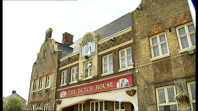 campaign to keep local pubs open; the dutch house pub with campaigners outside liam curran interview sot - losing more pubs than we lost in the... - surrounding wall点の映像素材/bロール