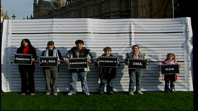 campaign to remove dna details of innocent children from database england london westminster white police lineup board outside houses of parliament... - grant shapps stock videos and b-roll footage