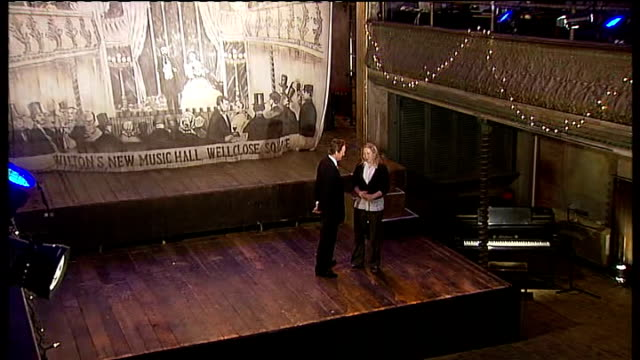 campaign to save wilton's music hall in london; england: london: aldgate: wilton's music hall: int frances mayhew interview with reporter on stage... - klimaanlage stock-videos und b-roll-filmmaterial