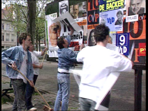 bv campaign workers for the flemish block party pasting up posters - poster stock-videos und b-roll-filmmaterial