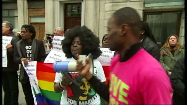 lgbt campaigner aderonke apata mounts legal bid to stop deportation to nigeria t28031441 / tx ext various shots of progay protesters demonstrating... - deportation stock videos & royalty-free footage