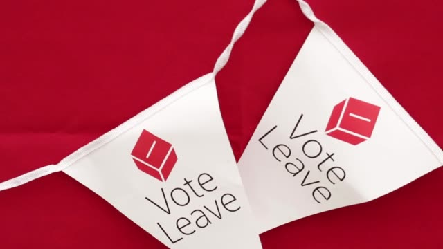 campaigners attach vote leave bunting to a table in manchester uk on saturday june 11 campaigners hand out promotional materials and talk to the... - 2016 stock videos & royalty-free footage