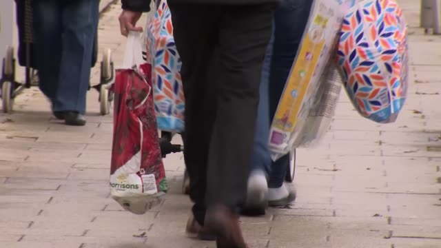 campaigners call for an increase in the cost of plastic bags; england: buckinghamshire: milton keynes: int various of man putting shopping in... - car stock videos & royalty-free footage