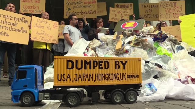 campaigners call on southeast asian leaders to ban trash imports from more developed countries at a protest in bangkok where demonstrators dump a... - freight transportation stock videos & royalty-free footage