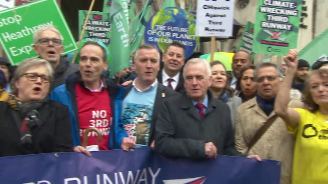 campaigners celebrating after the court of appeals ruled out a third runway at heathrow airport - john mcdonnell politician videos stock videos & royalty-free footage