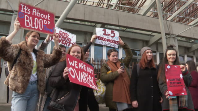 campaigners demonstrating for sanitary products to be made freely available for all in scotland - menstruation stock videos & royalty-free footage