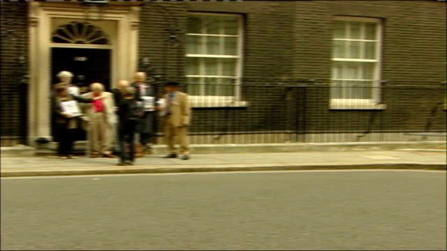 cnd campaigners drop petition off at downing street england london downing street ext general views of antitrident missile campaigners including... - trident stock videos & royalty-free footage