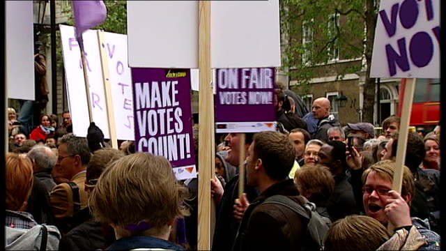 package *** campaigners for reform of the voting system chanting 'cameron clegg fair votes now' holding demonstration outside cabinet office with... - cathy newman stock-videos und b-roll-filmmaterial