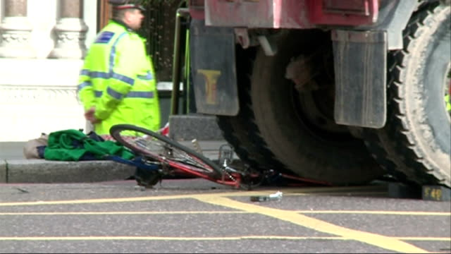 Campaigners hold mock funeral in protest over road safety T17101410 / Bicycle crushed beneath wheel of lorry Tipper truck in area of junction sealed...