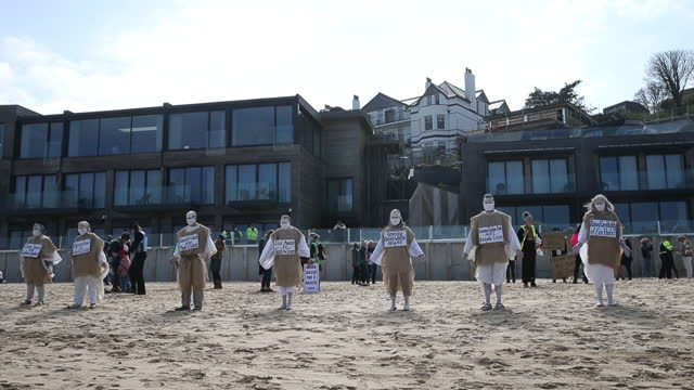 campaigners protesting against development work at the carbis bay hotel in west cornwall, which is set to hold the g7 summit talks in june, in carbis... - 麻袋点の映像素材/bロール