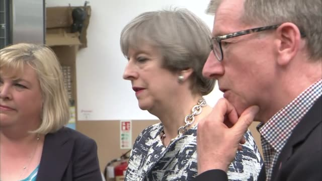 campaigning and interviews england nottinghamshire dunelm mill int theresa may enters room with husband philip may and both chat to workers / theresa... - husband stock videos & royalty-free footage