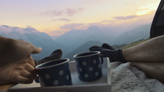 slo mo camper couple morning rest in the back of the car with coffee - cup stock videos & royalty-free footage