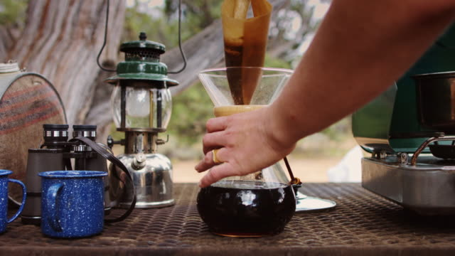 camper using pour-over coffee maker - camping stove stock videos and b-roll footage