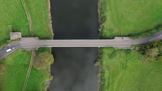 camper van crosses from england to wales over bigsweir bridge which spans the river wye between wales and england on october 15 in llandogo, wales.... - river stock videos & royalty-free footage