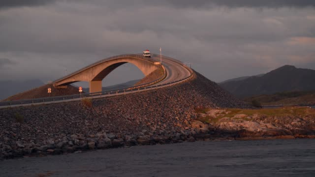 camper van on  atlantic road  at sunset - atlantic ocean stock videos & royalty-free footage