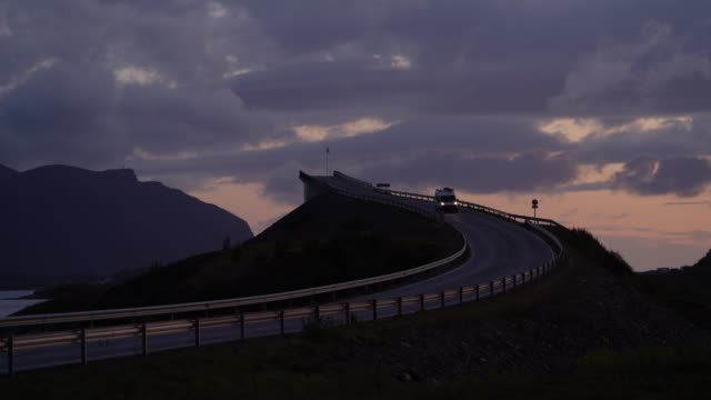 camper van on  atlantic road  at sunset - canoe stock videos & royalty-free footage