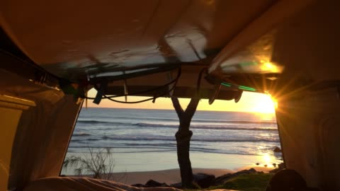 camper van sunrise with sun shining into the van with back door open orange light interior with surfboards - surfboard stock videos & royalty-free footage