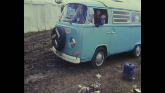 camper van towed out of mud by tractor after 1985 glastonbury festival at worthy farm, pilton, somerset - tractor stock videos & royalty-free footage