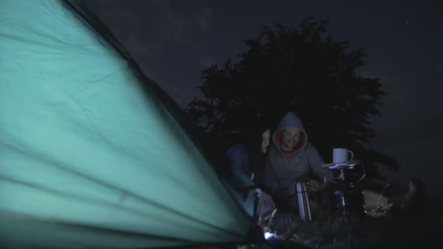 campers and camping tent at night - camping stove stock videos and b-roll footage