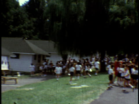 1973 ms campers throwing frisbees at carnival at camp sussex summer camp / sussex, new jersey - summer camp helper stock videos & royalty-free footage