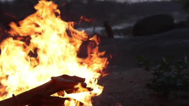 Campfire burning in grasslands
