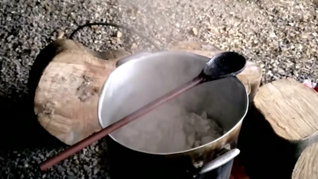 campfire cooking in slow motion - overflowing stock videos & royalty-free footage