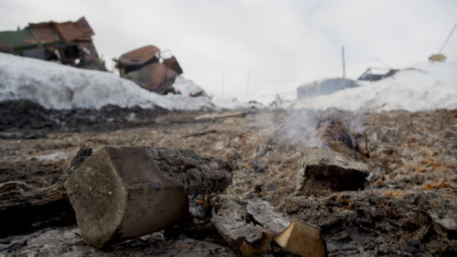 campfire extinguished at a garbage dump in barentsburg, svalbard - arctic stock videos & royalty-free footage