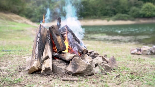 campfire next to lake - named wilderness area stock videos & royalty-free footage