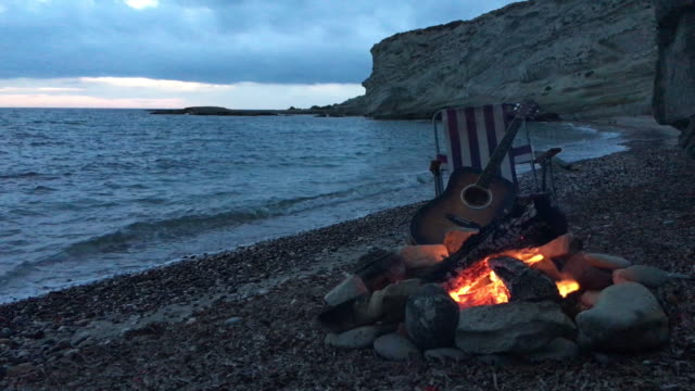 campfire on the beach with guitar - guitar stock videos & royalty-free footage