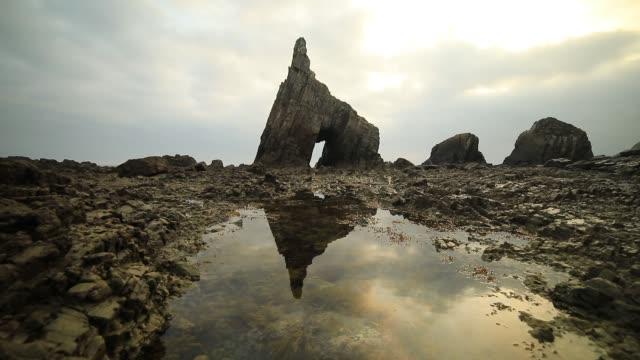 campiecho sea arch at asturias coastline, spain, bay of biscay - cave stock videos & royalty-free footage