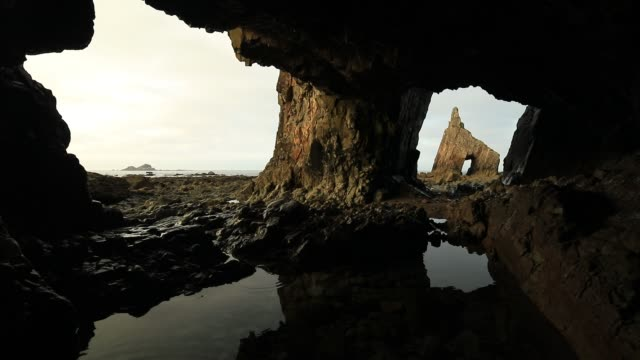 stockvideo's en b-roll-footage met campiecho sea arch at asturias coastline, spain, bay of biscay - grot